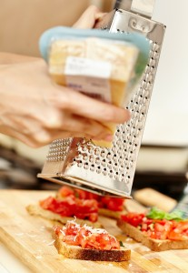 Parmesan being grated
