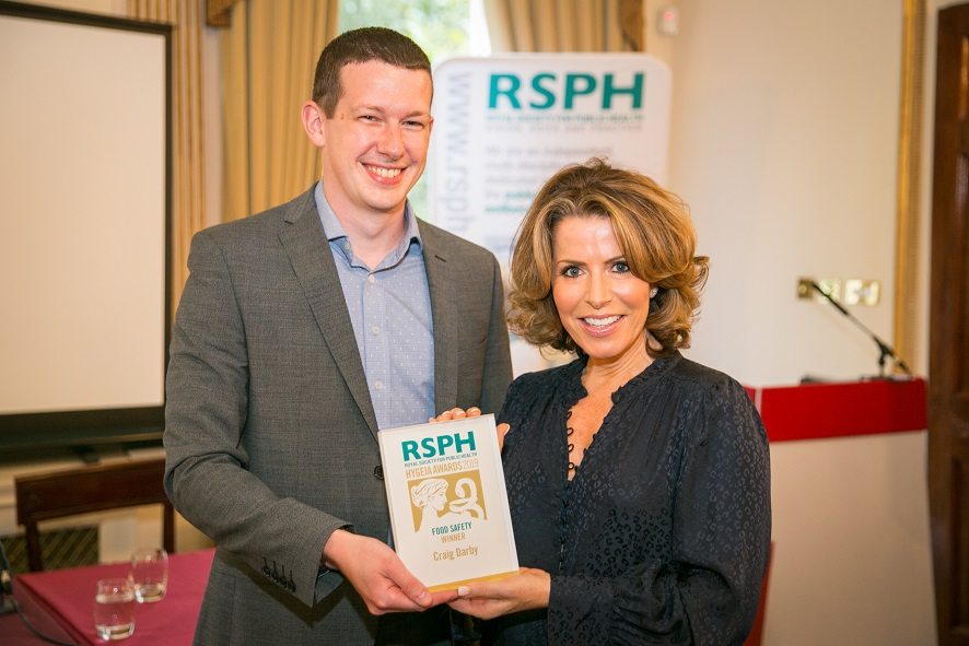 Craig Darby receives his award fro Natasha Kaplinsky